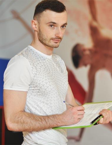 Trener personalny i fizjoterapeuta Tomasz Maliński