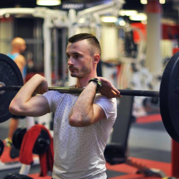 Trener personalny Tomasz Maliński - przysiad front squat
